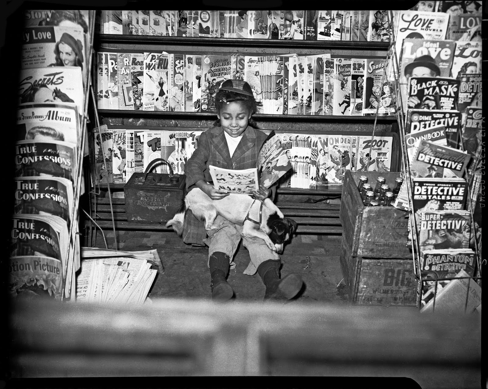 "Girl reading comic book in newsstand, c. 1940–1945. Photograph by Charles ""Teenie"" Harris courtesy of Eyes on Pittsburgh and the Carnegie Museum of Art"