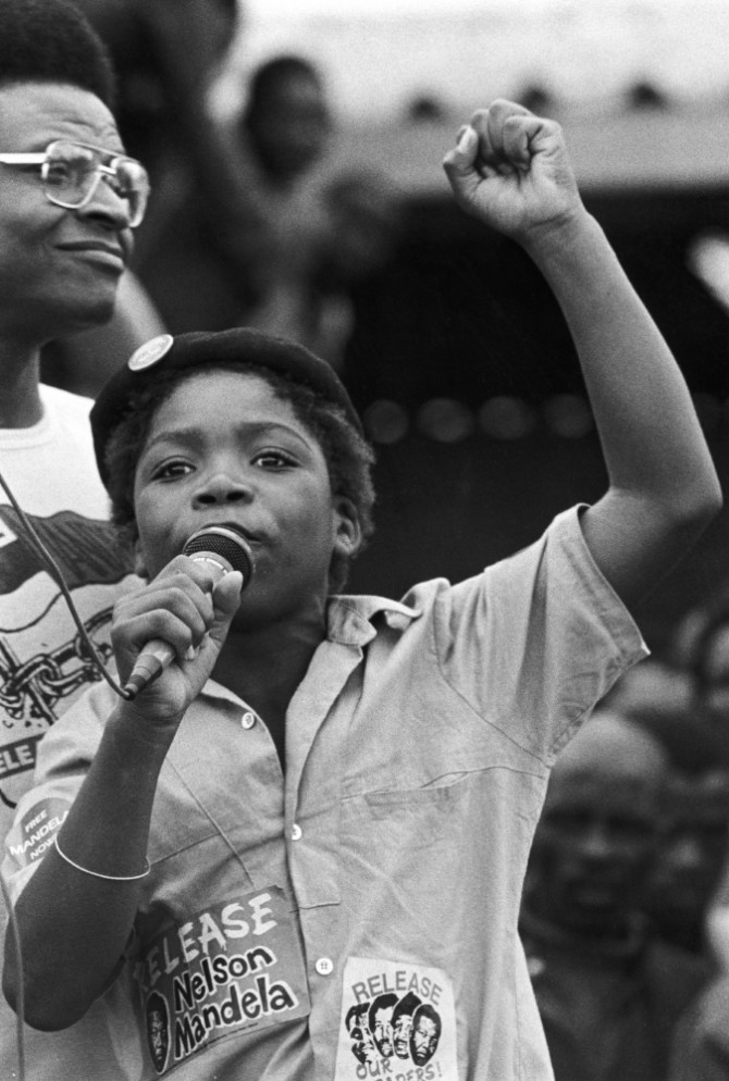 A young girl at a demonstration for the release of Nelson Mandela circa the 1960s. Photo courtesy of the ANC archives.